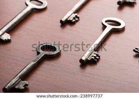 Many keys on the table - stock photo