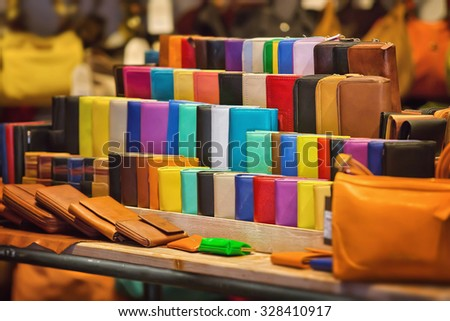 Many kinds of purses in different colors - stock photo