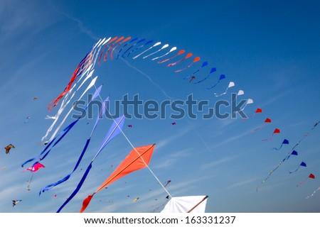 many kites flying in the blue sky - stock photo