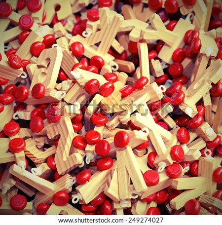 many letters in wood with Red wheels to compose words and name - stock photo