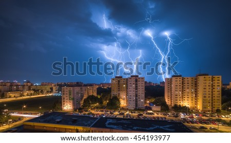 Many Lightnings Over Housing Estate. Night Storm in the City. - stock photo