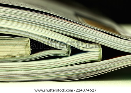 many magazines stack, close up shooting - stock photo