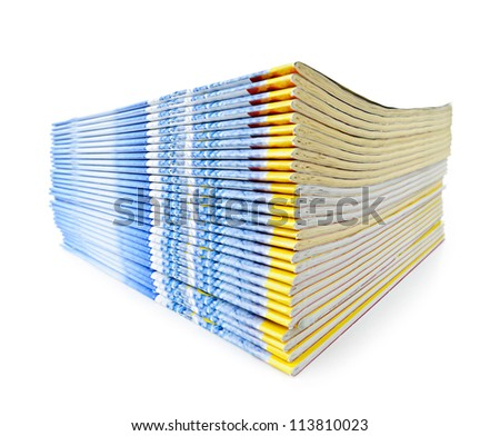 Many magazines stacked in a pile isolated on white - stock photo