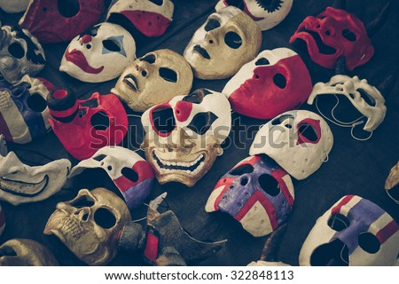 many masks laid down on the floor - stock photo