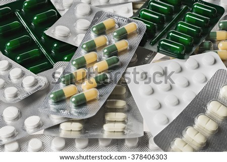 Many medicine pills and tablets. Colorful capsules and tablets  closeup - stock photo