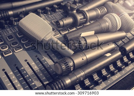 many microphone on audio mixer's in vintage tone - stock photo