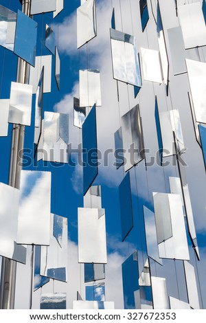 Many mirrors over blue sky with clouds - stock photo