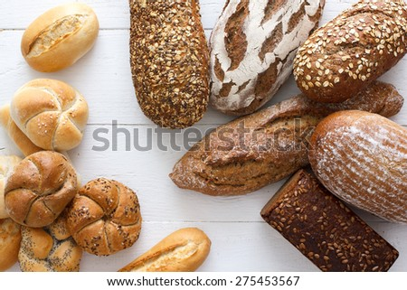 Many mixed breads and rolls shot from above. - stock photo