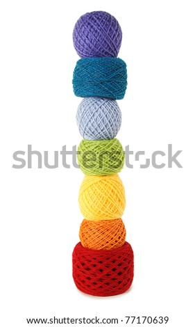 many multicolored clews in a vertical row, isolated - stock photo