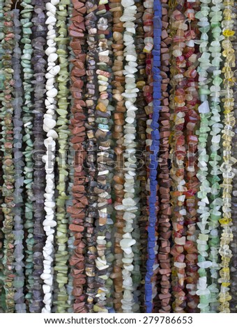 Many necklaces of semiprecious stones in store - stock photo