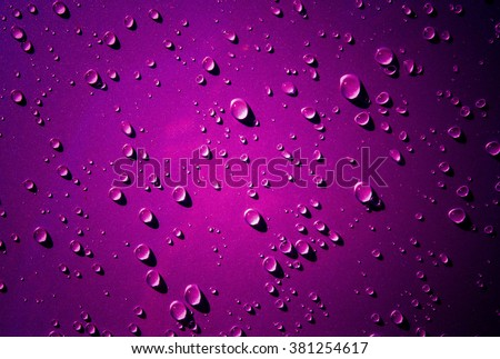 Many of raindrops stuck on the Car Hood background,Abstract of raindrops on the Car Hood made with dark pink color filters. - stock photo