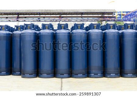 Many of the Gas bottles balloons with propane butane, in storage - stock photo