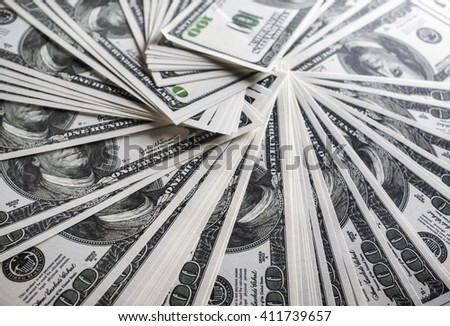 Many one hundred dollar bills. Much money. A lot of money. Fake money. Selective focus. - stock photo