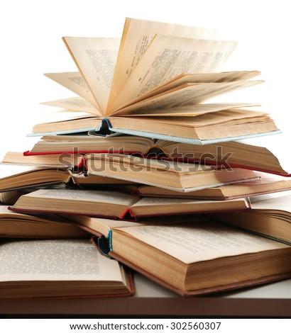 Many open books isolated on white - stock photo