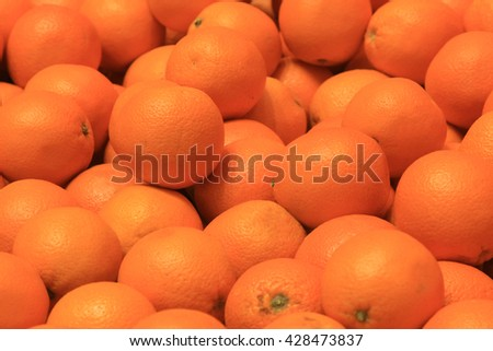 Many oranges as a background for design drawings - stock photo