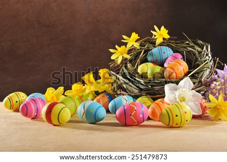 many painted easter eggs with easter nest and hyacinth  - stock photo