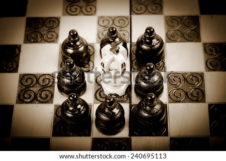 many pawn against Chess king, playing old wooden chess, sepia and vintage version,  - stock photo