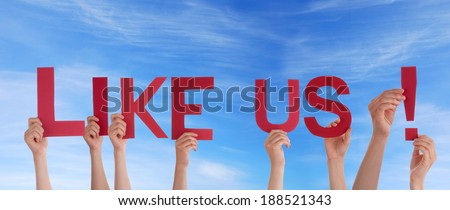 Many People Holding the Red Words Like Us in the Sky - stock photo