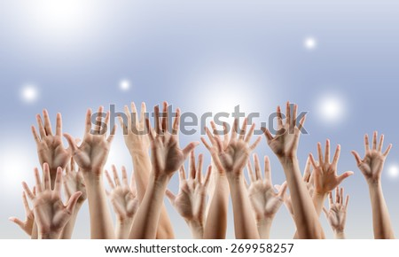 Many people's hands up. Copy space. - stock photo