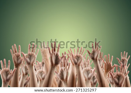Many people's hands up isolated on gradient green background. Various hands lifted up in the air. Clipping path. Copy space. - stock photo