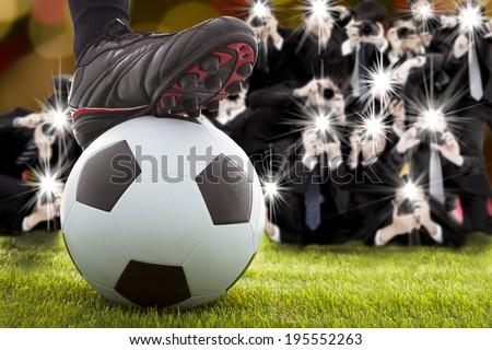 many photographer taking winner soccer player feet on field - stock photo
