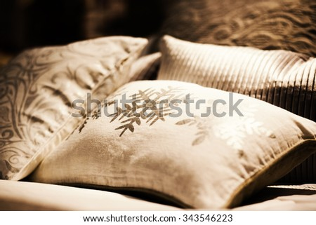 many pillows on the bed - stock photo