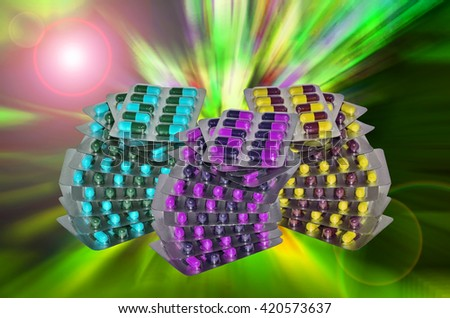 Many Pills in a blister pack on green light background - stock photo