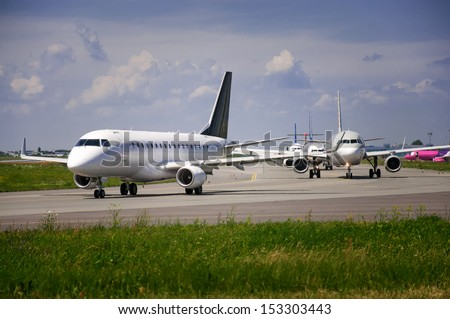 many planes waiting for take-off - stock photo
