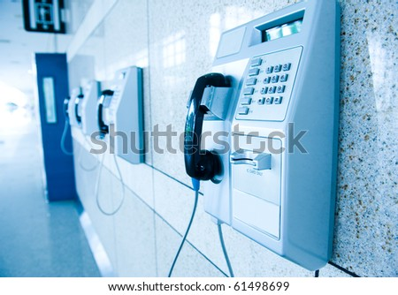 many public telephones in one single installation site. - stock photo