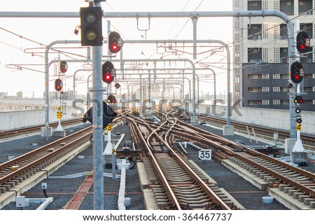 Many railway tracks near the railway station - stock photo
