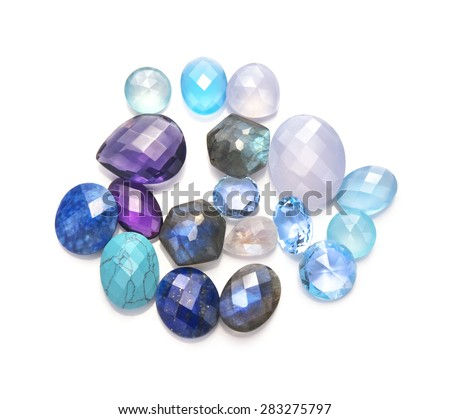 Many real blue gems: turquoise, lapis lazuli, blue topaz, aquamarine, moonstone rainbow, blue chalcedony, aqua chalcedony isolated on white background. - stock photo