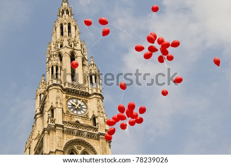 Many red balloons in front of the town hall in Vienna, Austria - stock photo