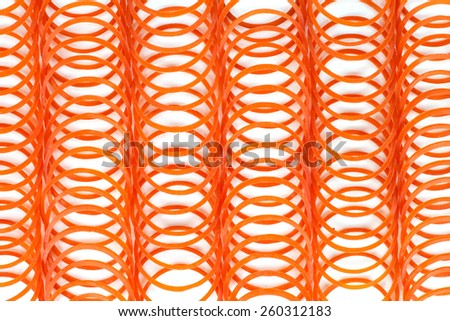 many red rubber bands on white background - stock photo