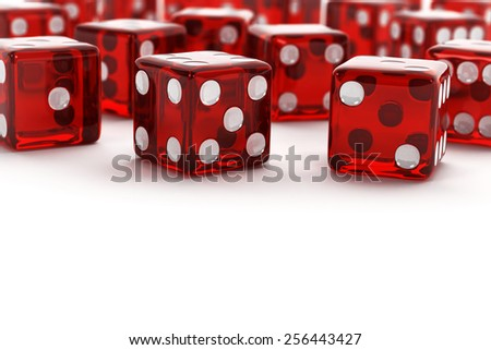 Many red semi transparent dice with selective focus on white background. - stock photo
