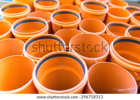 Many red sewage pipes in a stack - stock photo