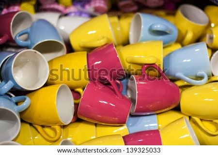 many red yellow and blue cups on store - stock photo