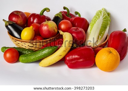 Many ripe vegetables and fruit are spread out on a white background - stock photo