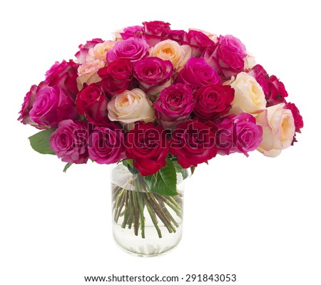 Many roses of red, pink and yellow colors in a vase isolated on white - stock photo