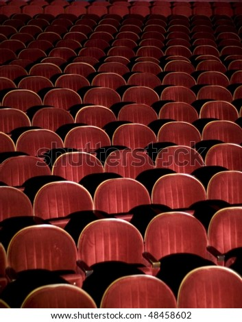 Many rows of red auditorium chairs - stock photo
