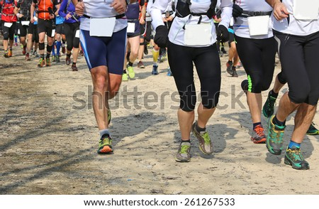 many runners involved in the outdoor race - stock photo