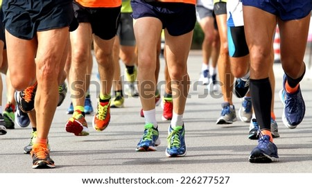 many runners to race to the finish line of the marathon - stock photo