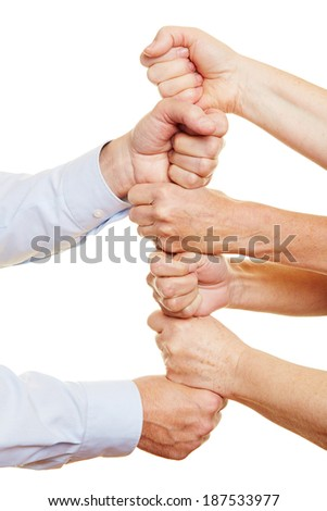 many senior people stacking their fists to build a tower - stock photo