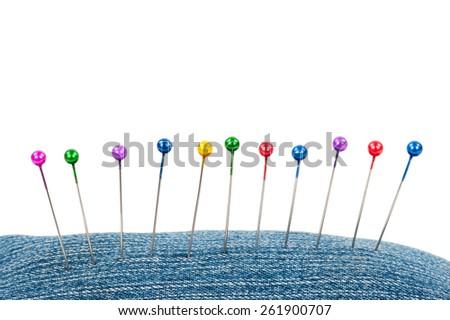 Many sewing push pins - stock photo