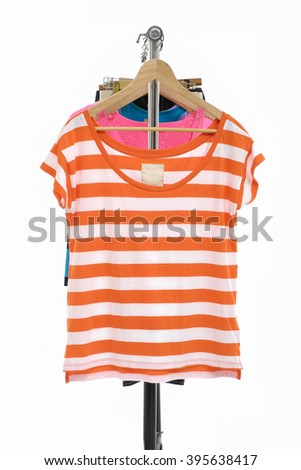 many shirt hanging on wooden hangers - stock photo