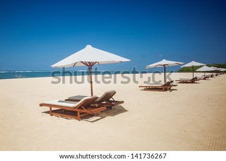 Many sitting on the beach - stock photo