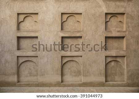 Many small arches on the grunge wall. Interior details of old arabic house. - stock photo