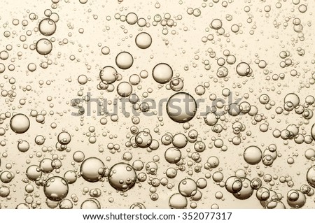 Many small champagne bubbles in a glass of champagne - stock photo