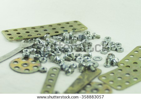 Many small parts nuts and bolts - stock photo