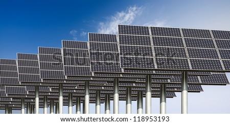 many solar energy panels against a blue sky - stock photo