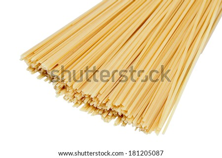 Many spaghetti prepared for cooking isolated on white background - stock photo